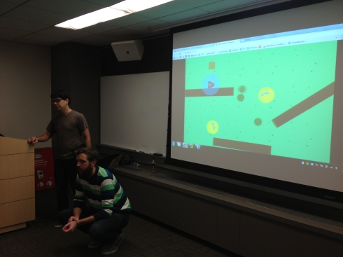 Studio Mercato's Chris Hernandez (standing) and Jon Stokes (action crouching) show off an example Construct 2 project.